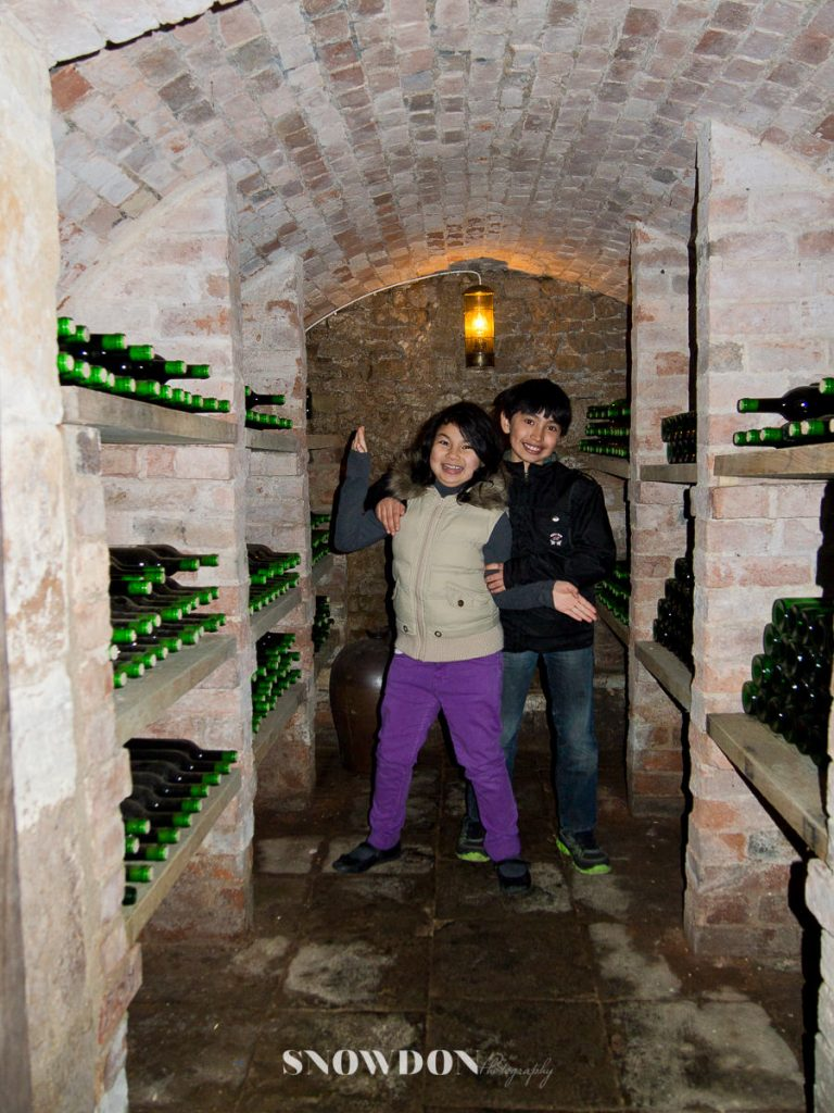 Posing in the cellar saying papa will like this place!