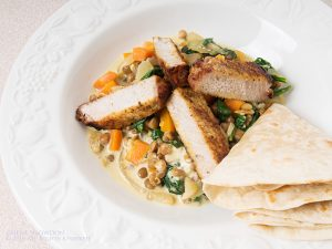 Spiced pork with creamy lentils & tortillas